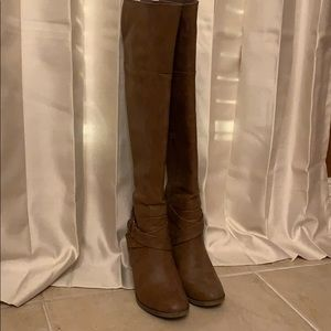 Brown knee high boots.